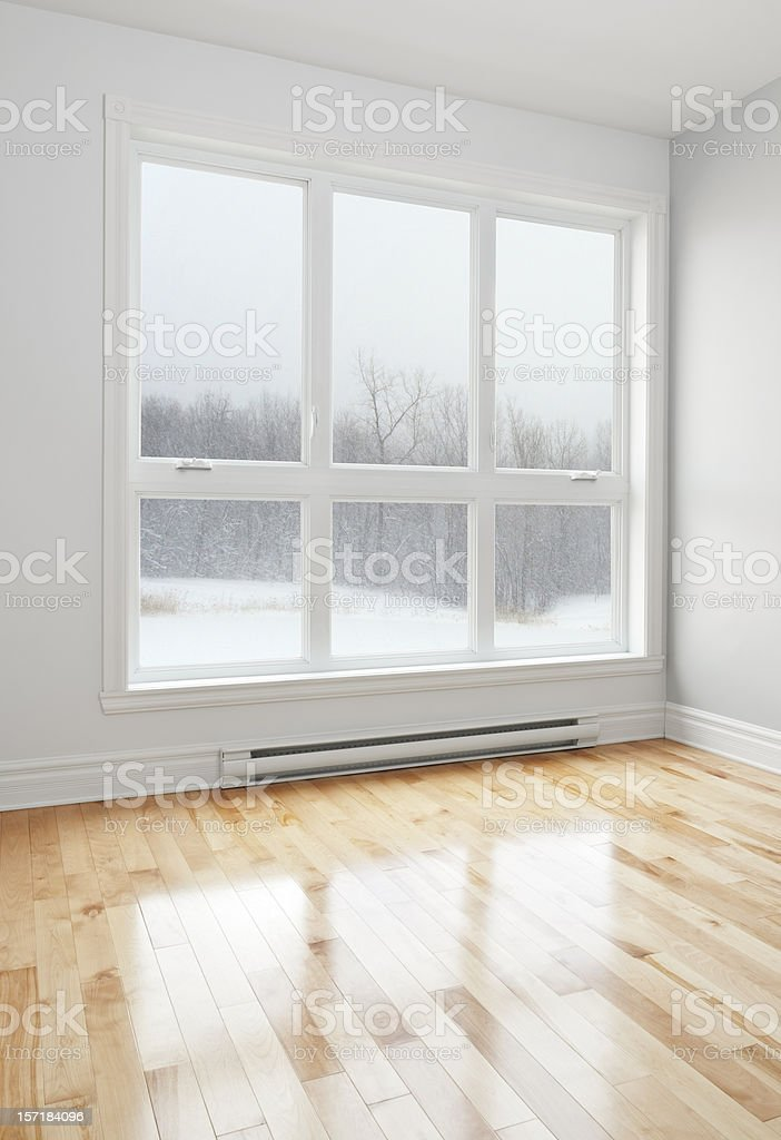 Empty room and winter landscape seen through the window stock photo