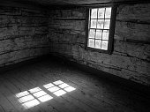 istock Empty Room in Old Log Cabin 866411516