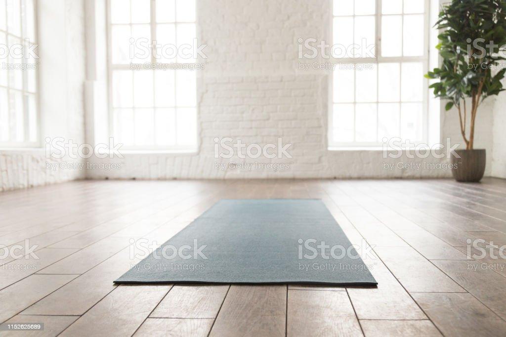 Empty Room In Yoga Studio Unrolled Yoga Mat On Floor Stock Photo Download Image Now Istock