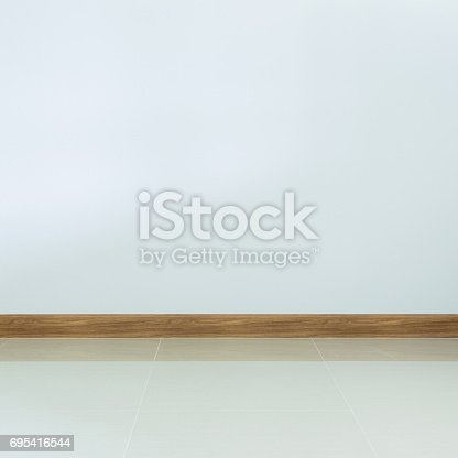 istock empty room interior, white tile floor and white mortar wall background 695416544