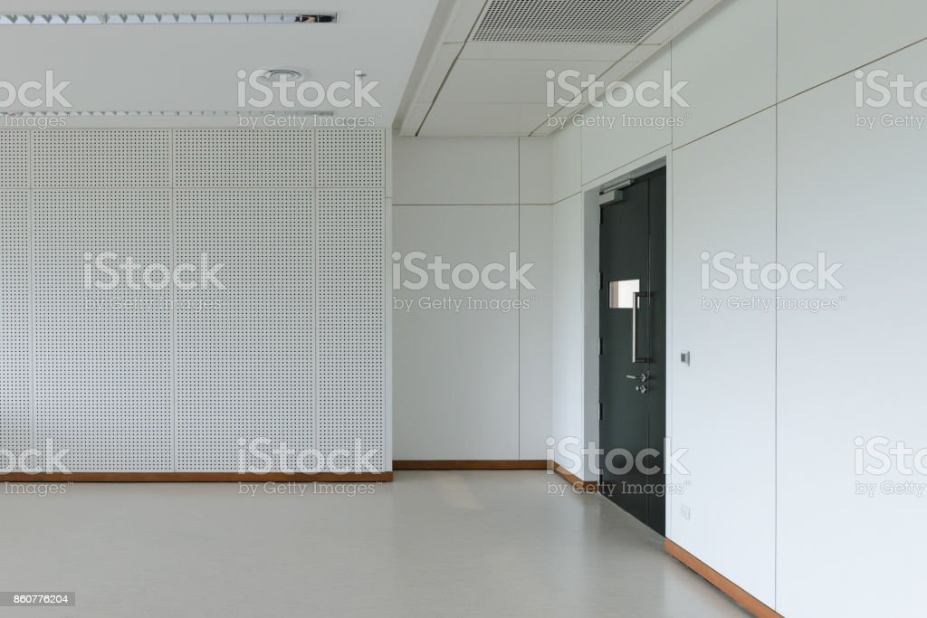 Empty room modern interior - floor with soundproof wall and door stock photo