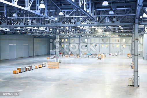 182889461 istock photo empty room of modern storehouse 182879132