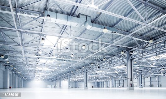 182889461 istock photo empty room of modern storehouse 182889461