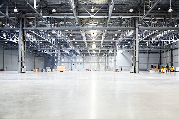 empty room of modern storehouse empty room of modern storehouse with forklift truck loader on a foreground and office rooms warehouse interior stock pictures, royalty-free photos & images