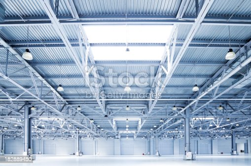 182889461 istock photo empty room of modern storehouse 182889480