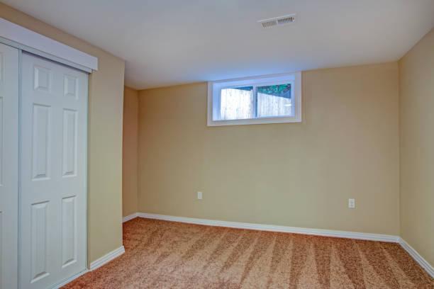 Empty room, sand beige walls, carpet floor in a luxury home. stock photo