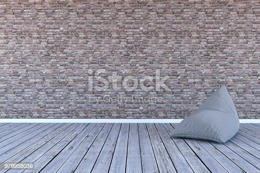 629801250 istock photo Empty room with beanbag and brick wall 979958036