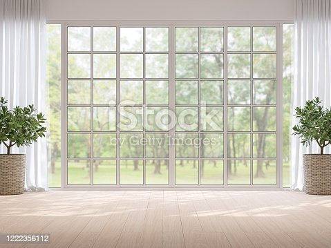 994217090 istock photo Empty room with blurry nature background 3d render 1222356112