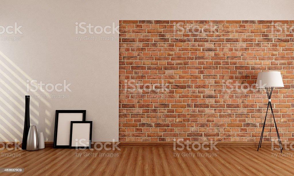 Stanza vuota con muro di mattoni - foto stock