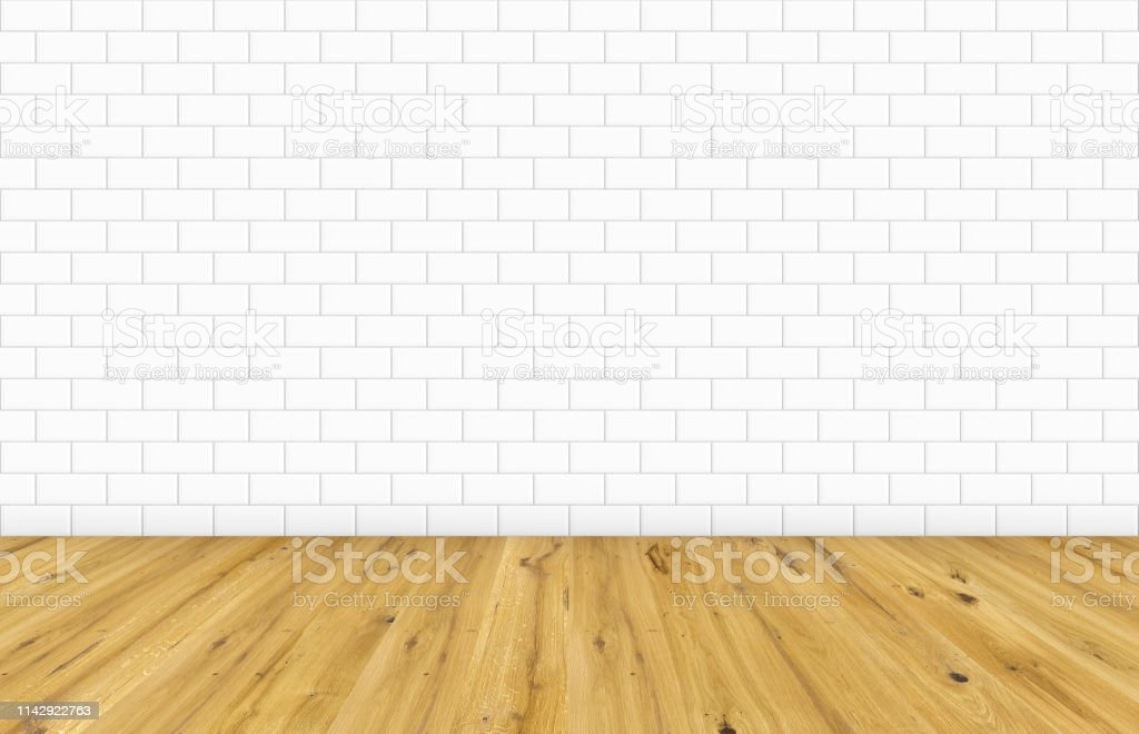 Empty room with brown wooden floor and classic white metro tiles...