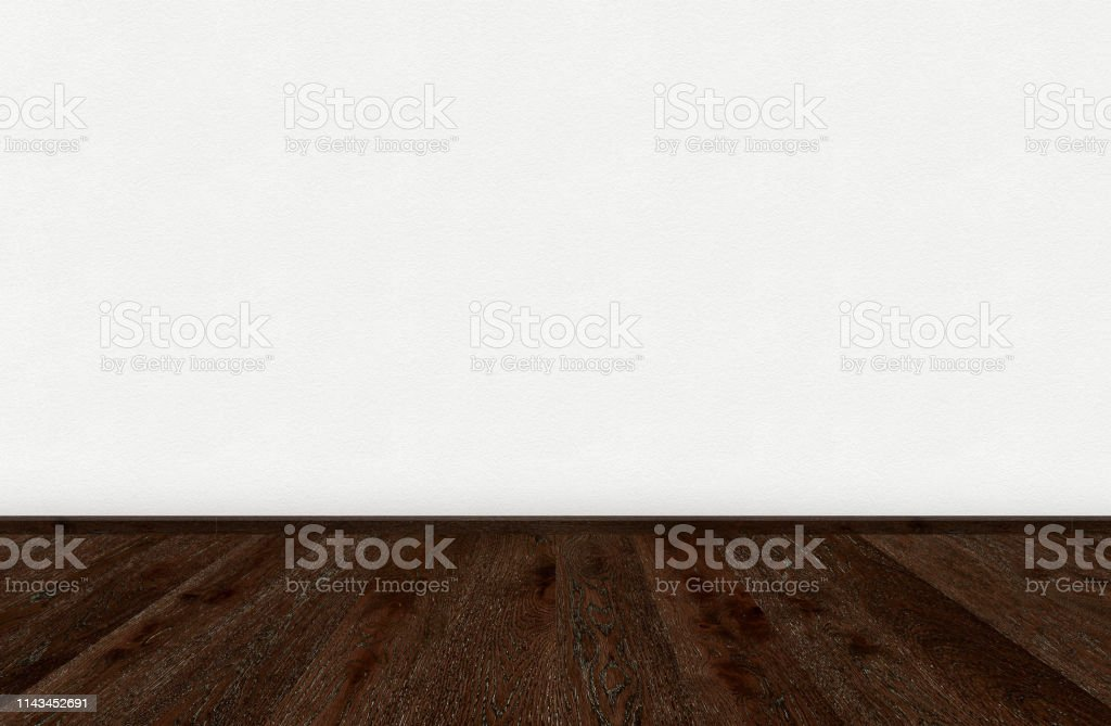 Empty room with dark brown wooden floor and blank white painted wall....