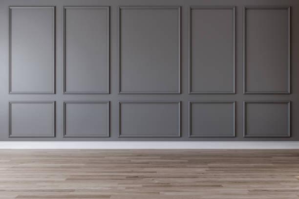 empty room with dark gray wall, moldings and wooden floor - sztukateria zdjęcia i obrazy z banku zdjęć