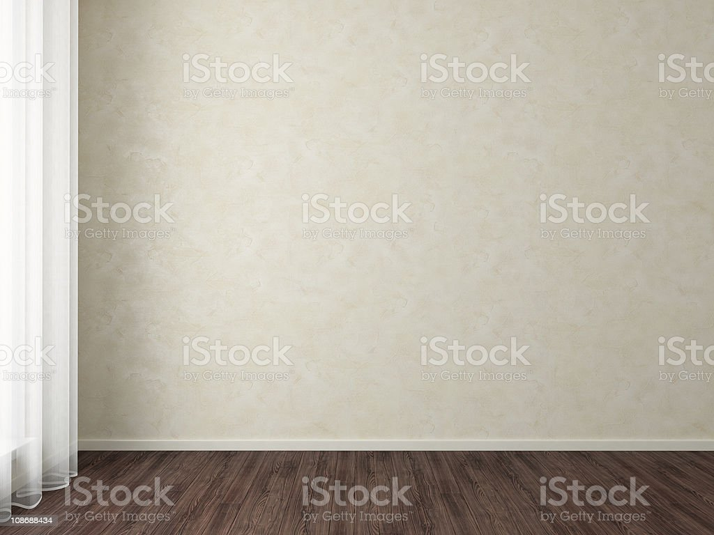 Empty room with dark wood floors and beige wallpaper stock photo