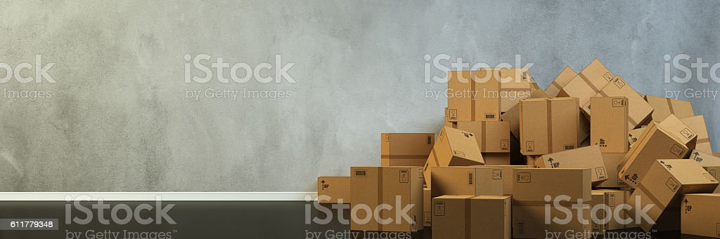 Empty room with many shipping boxes stock photo