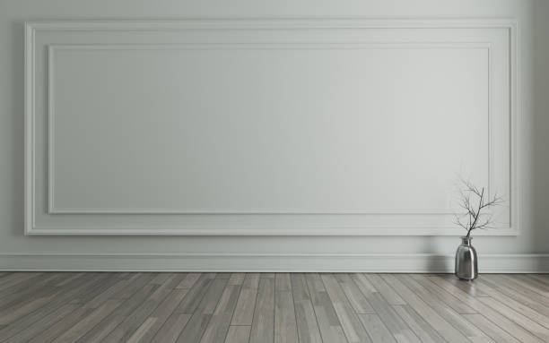 Empty room with Modern classic wall panels, metalic vase, dry plant and wooden floor 3D rendering stock photo
