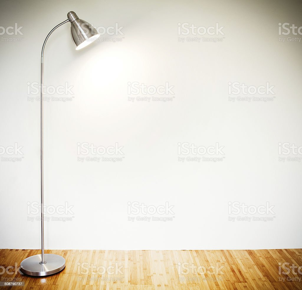 Empty room with modern floor lamp stock photo