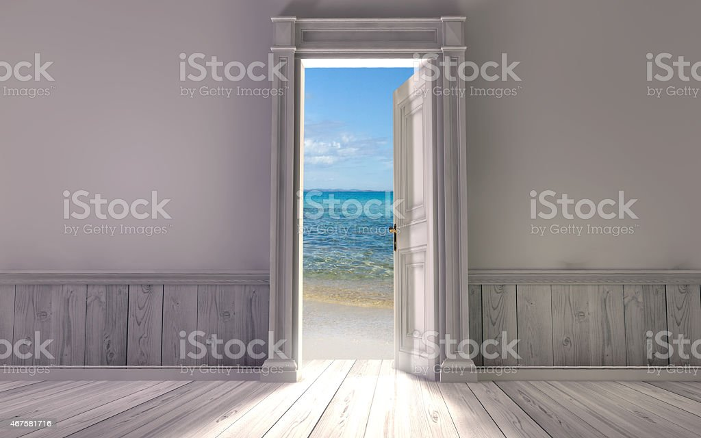 Empty room with opened door facing the sea stock photo
