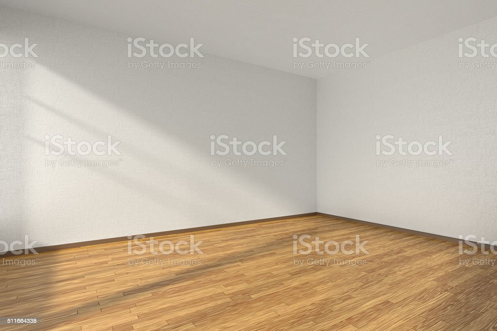 Empty room with parquet floor and textured white walls stock photo