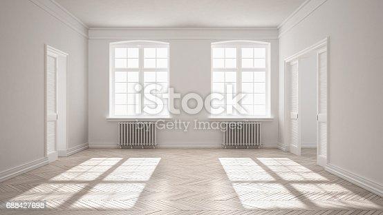 521806786 istock photo Empty room with parquet floor, big windows, doors and radiators, white interior design 688427698