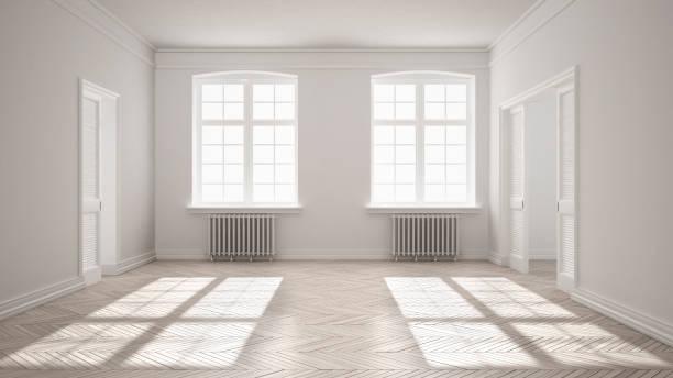 Empty room with parquet floor, big windows, doors and radiators, white interior design stock photo