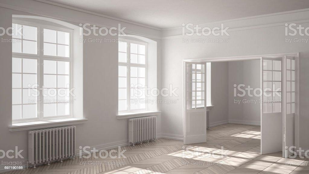Salle vide avec sol en parquet, grandes fenêtres, portes et radiateurs, design d'intérieur blanc photo libre de droits