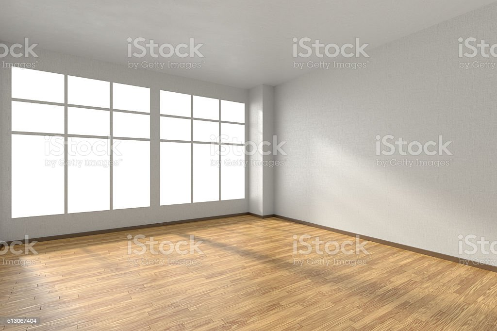 Empty room with parquet floor, textured white walls and window stock photo