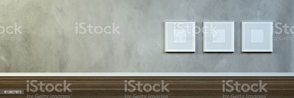 Empty room with some blank frames stock photo