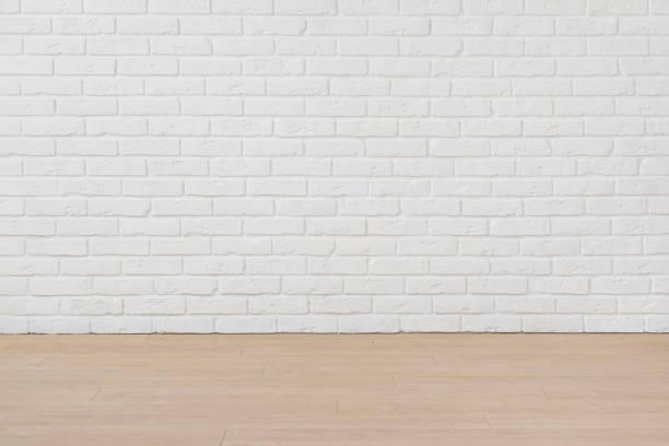 흰색 벽돌 벽과 적층 바닥 보드빈 방 - 흰색 벽돌 담 뉴스 사진 이미지