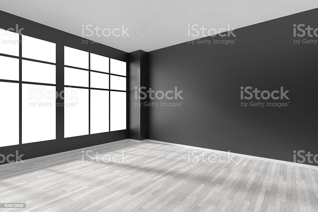 Empty room with white parquet floor, black walls and window stock photo