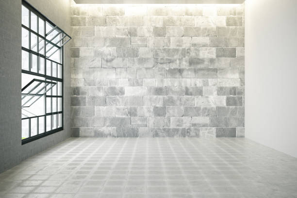 Empty Room with Windows and Concrete Wall stock photo