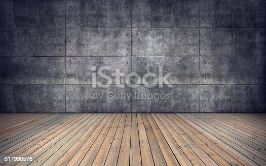 istock Empty room with wooden floor and concrete tiles wall 517990578