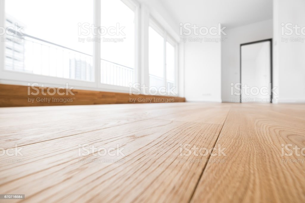 empty room, wooden floor in new apartment