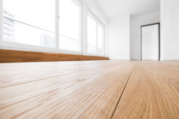 empty room, wooden floor in new apartment stock photo