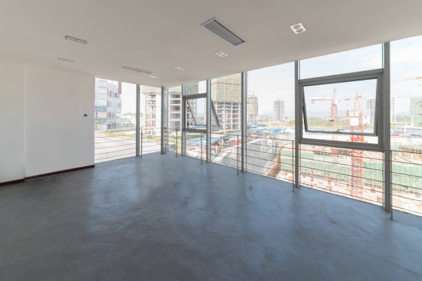 Empty rooms and buildings outside the window Empty rooms and buildings outside the window cement floor stock pictures, royalty-free photos & images