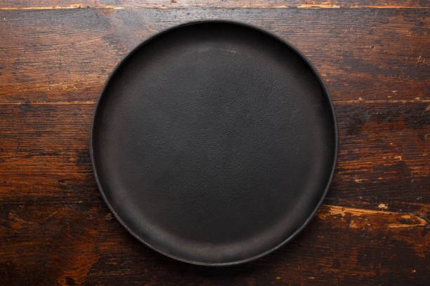 Empty round cast-iron pan stock photo
