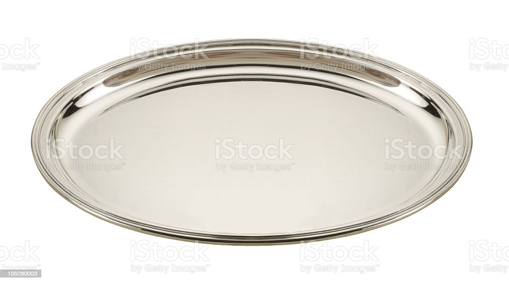 A empty round silver plate on a white background stock photo