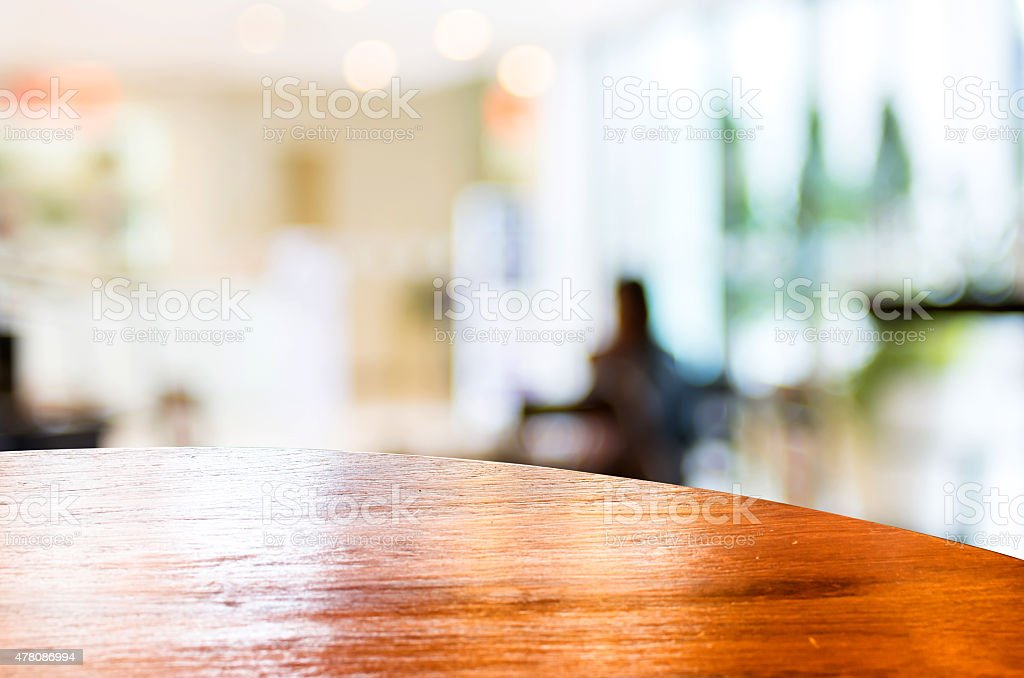Empty round table top at coffee shop blurred background stock photo