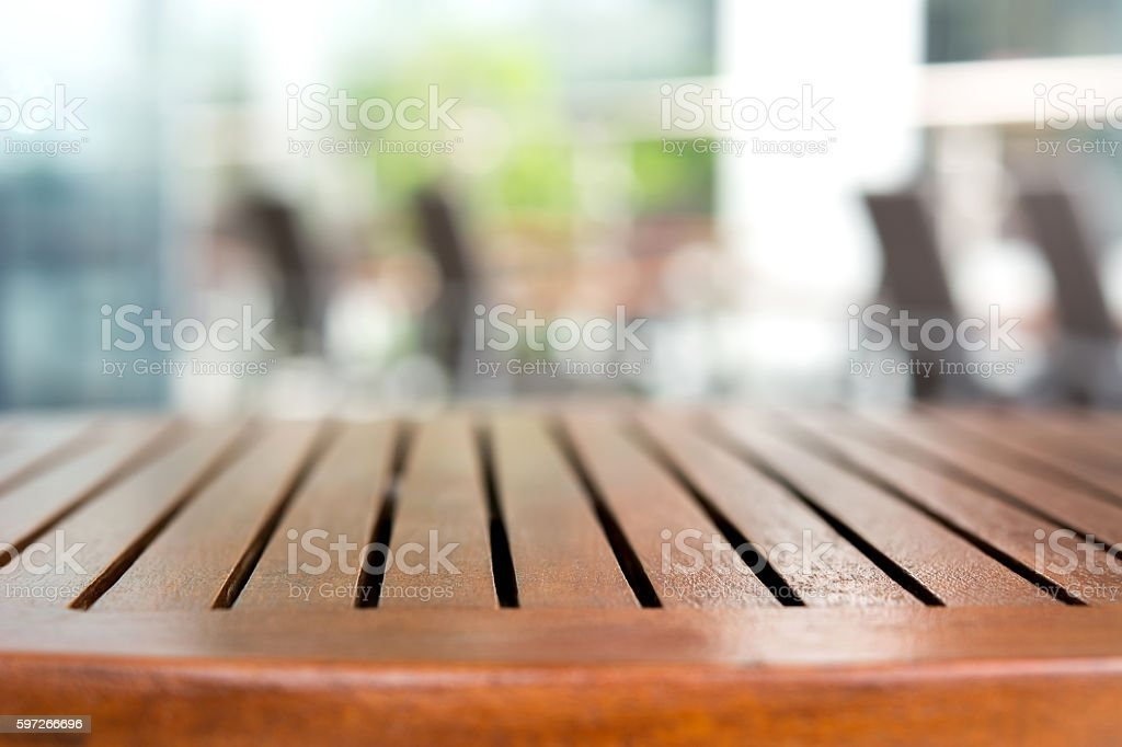 Empty round wood table top in outdoor restaurant royalty-free stock photo