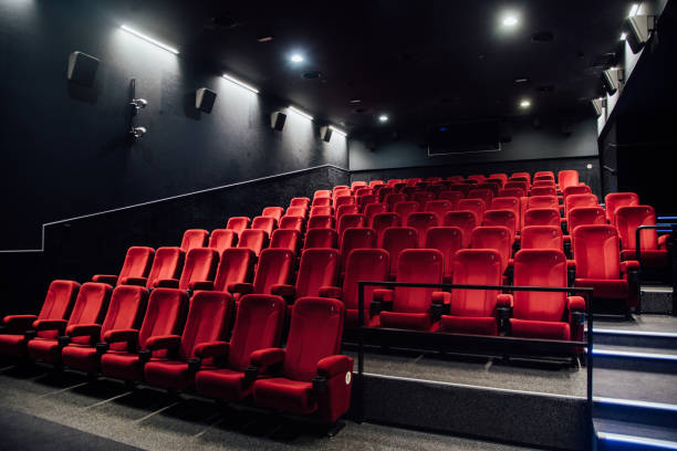 Empty rows of red seats Empty cinema right before the movie premiere movie theater stock pictures, royalty-free photos & images