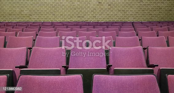 Empty rows of seats in auditorium or concert hall.Close up,selective focus.Concept of quarantine,curfew,cancellation of mass events to prevent coronavirus,losses of organizers in entertainment sector