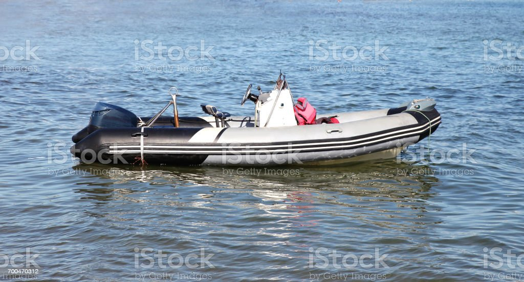 Empty rubber motorboat stands on a water background stock photo