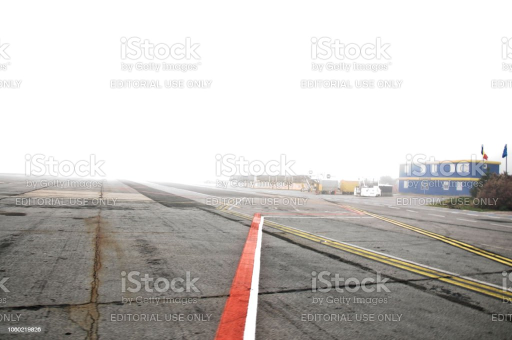 Empty Runway On A Bad Weather Autumn Day At Timisoara Traian Vuia International Airport, (IATA: TSR, ICAO: LRTR) Romania stock photo