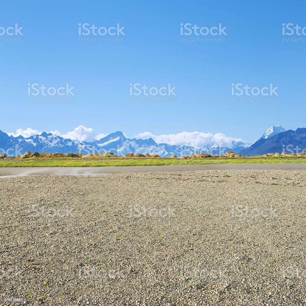 empty rural road near snow mountains  in new zealand stock photo