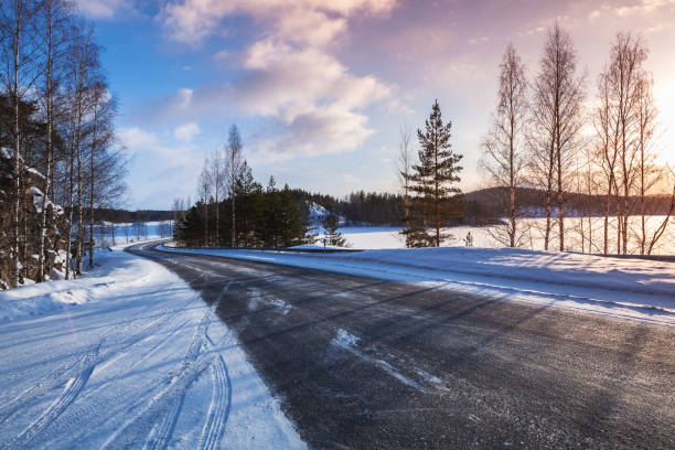 Empty rural road on a lake coast, winter stock photo
