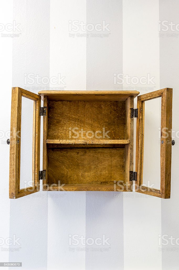 Empty rustic wall mounted display cabinet, vertical. stock photo