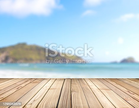 Empty rustic wood with sea coast background blurred. Ready for put your product display and shelf montage concept with copy space. Wooden stage for objects presentation.