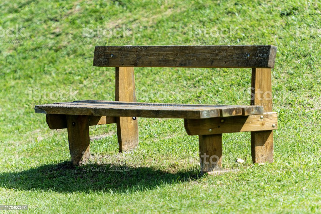 Empty Rustic Wooden Bench In A Public Park Stock Photo Download Image Now Istock