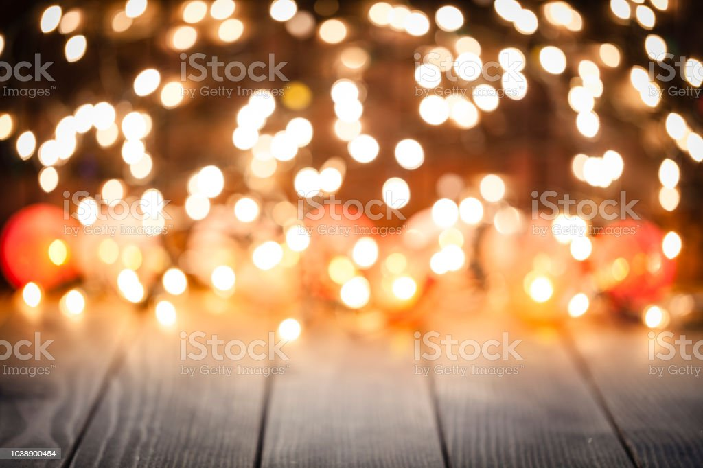 empty rustic wooden table with blurred christmas lights at background royalty free stock photo - Blurred Christmas Lights