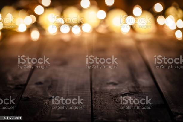 Empty rustic wooden table with blurred christmas lights at background picture id1041796884?b=1&k=6&m=1041796884&s=612x612&h=fyjl3ticcdj8uqkgg808fuf8rcnorjc9qywt0zodmvk=