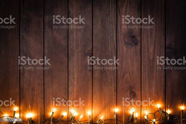 Empty rustic wooden table with christmas lights border picture id1007229878?b=1&k=6&m=1007229878&s=612x612&h=jhgy6ndlijd6ydwxqtn9xlzuwohbcmiznrrzuxs8jhy=